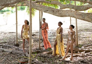 Photograph of four models with fashion clothes on a Jamaican beach