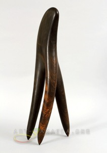 A wooden sleek sculpture made of polished wood