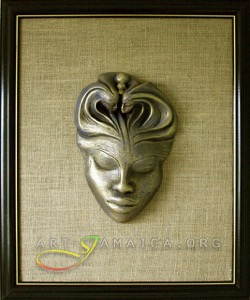 A silver mask framed by a wooden frame and beige background